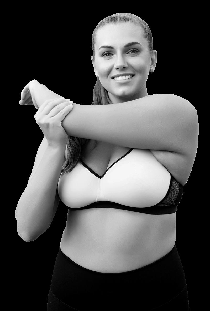 femme sportive bien dans son corps qui s'étire